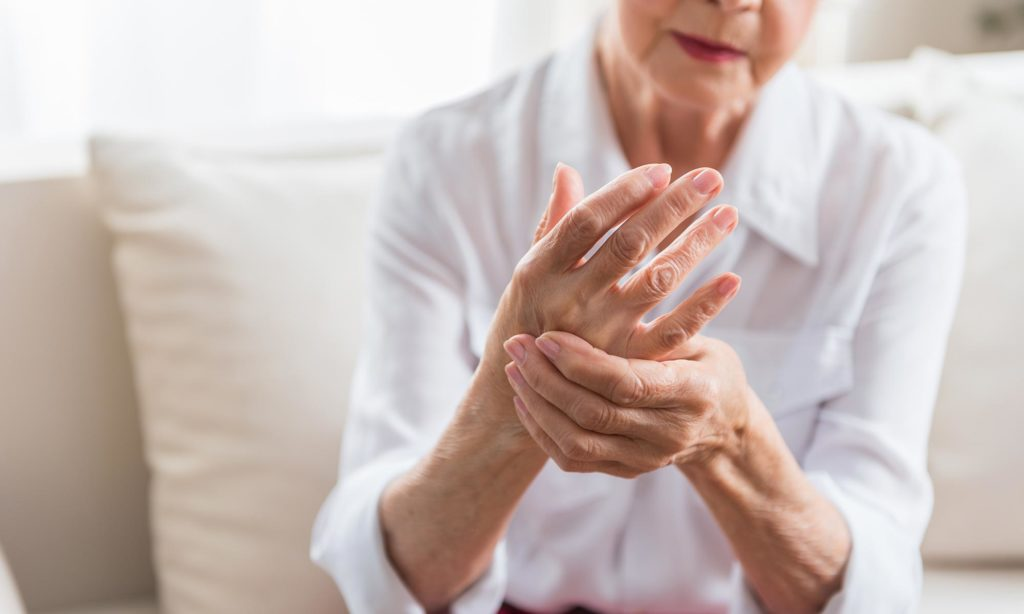 A senior suffering from arthritis